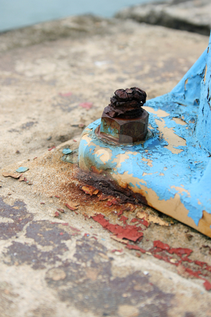 Rust stock photo, Rusted old bolt and screw on a blue lamp post foot by Vanessa Van Rensburg