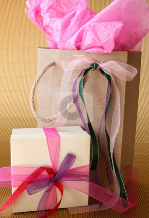 Gifts stock photo, Cream colored gift box and brown gift bag with ribbons by Vanessa Van Rensburg
