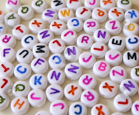 Letters stock photo, Small Colorful letters on different white shapes by Vanessa Van Rensburg