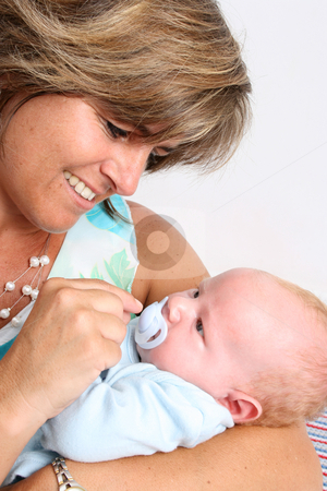 Baby Boy stock photo, Baby boy cuddled by his friendly auntie by Vanessa Van Rensburg