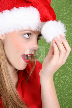 Christmas Teen stock photo, Teenager with red lips wearing a christmas hat by Vanessa Van Rensburg