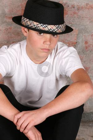 Casual Teen stock photo, Teenage boy wearing a black hat in casual wear by Vanessa Van Rensburg