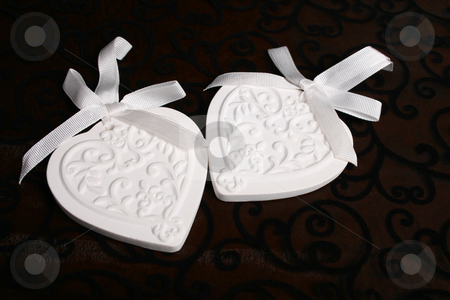 Ceramic Hearts stock photo, White Ceramic hearts with white ribbons tied by Vanessa Van Rensburg