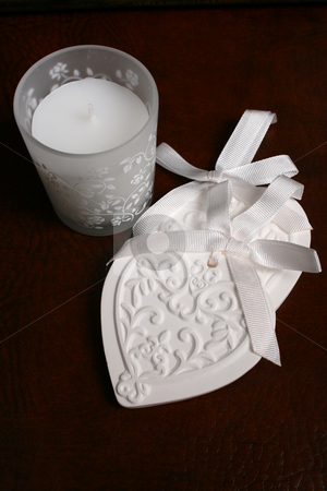Ceramic Heart stock photo, White Ceramic hearts with candle in glass by Vanessa Van Rensburg