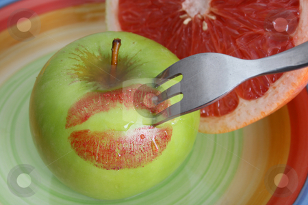 Apple and Pomelo stock photo, Sliced Pomelo and a whole apple with red lips by Vanessa Van Rensburg
