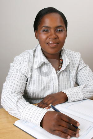 Businesswoman stock photo, Business Woman with a pen in hand on diary by Vanessa Van Rensburg