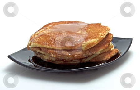 Pancakes stock photo, Pancakes with syrup on a black plate, white background by Fabio Alcini