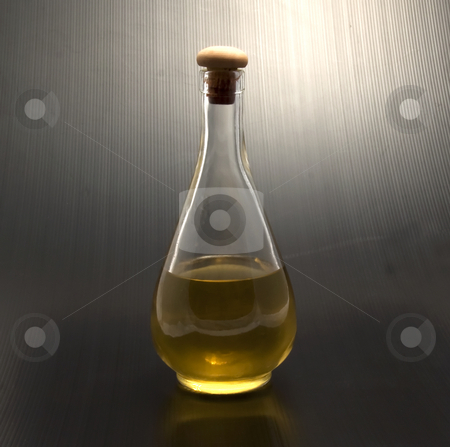Grappa stock photo, Solitary bottle of Italian alcoholic beverage by Fabio Alcini