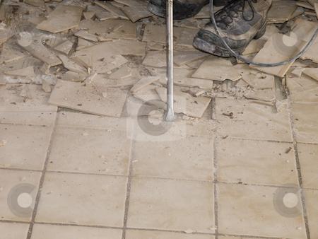Demolition of ceramic floor tile during home renovation stock photo, Photo image of ceramic floor demolition during a home renovatopn by P.J. Lalli