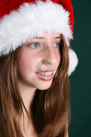 Christmas Hat stock photo, Brunette Teenager wearing a fluffy christmas hat by Vanessa Van Rensburg