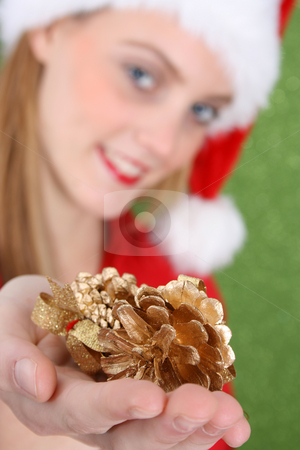 Christmas Decorations stock photo, Teenager with red lips presenting Christmas Decorations. FOCUS on decorations by Vanessa Van Rensburg
