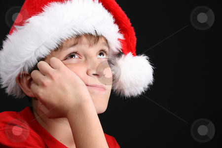 Christmas Boy stock photo, Young boy wearing a red shirt and christmas hat by Vanessa Van Rensburg