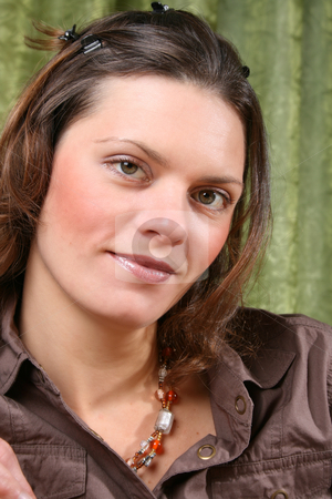 Beautiful Woman stock photo, Beautiful brunette female wearing a brown shirt against a green background by Vanessa Van Rensburg