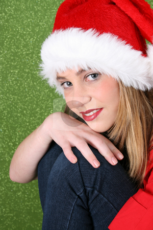 Christmas Teen stock photo, Christmas teen resting on her knee, with a happy smile by Vanessa Van Rensburg