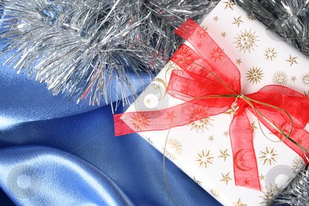 Christmas Gifts stock photo, Wrapped christmas gifts with tinsel and bow by Vanessa Van Rensburg