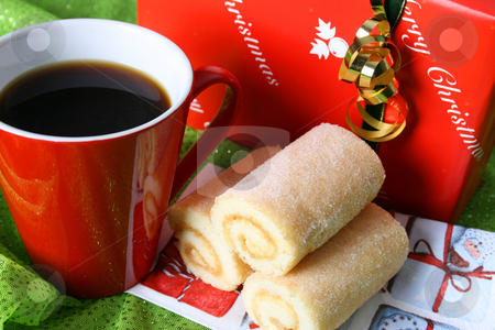 Christmas Day Coffee stock photo, Christmas morning coffee with a gift and swiss roll by Vanessa Van Rensburg