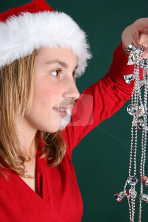 Christmas Girl stock photo, Beautiful teenager wearing a red shirt and christmas hat by Vanessa Van Rensburg