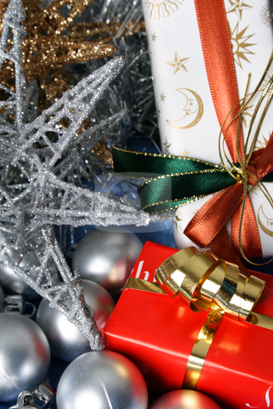 Christmas Gifts stock photo, Wrapped christmas gifts with tinsel and decorations by Vanessa Van Rensburg