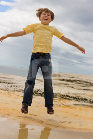 Jump for Fun stock photo, Boy jumping up and down. by Leah-Anne Thompson
