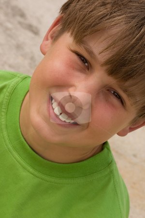 Smiley Boy stock photo, Smiling boy wearing a green t-shirt - angled. by Leah-Anne Thompson