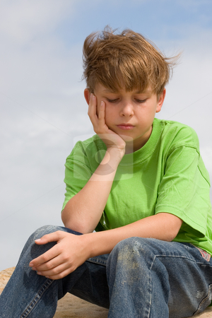 Solemn Thoughts stock photo, A child sitting and thinking. by Leah-Anne Thompson