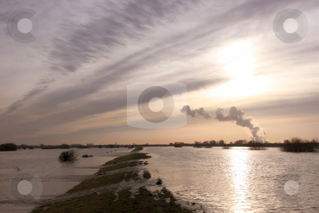 Winter floods stock photo, Winter flood waters and sundown over a distant power station by Mike Smith