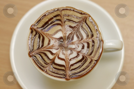 Cappucino stock photo, A cup of cappucino above perspective by Leah-Anne Thompson