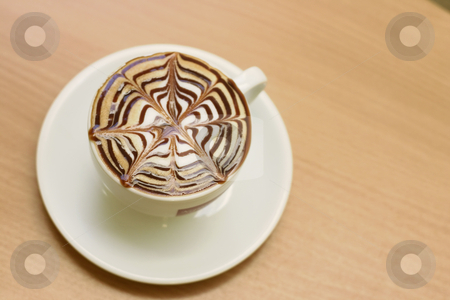 Capuccino on a cafe table stock photo, Hot capuccino by Leah-Anne Thompson