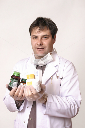 Doctor holding variety of  medications stock photo, Doctor with supplements and medications by Leah-Anne Thompson