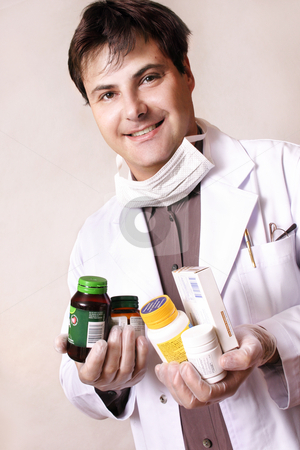 Medicines and supplements stock photo, Doctor holding a variety of medicines and supplements by Leah-Anne Thompson