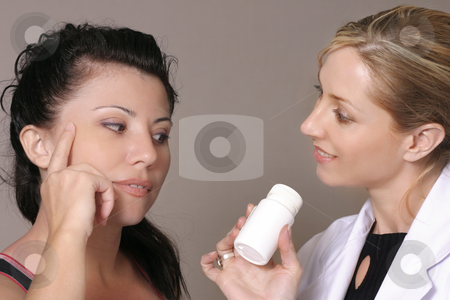 Advice stock photo, Considering nutritional, dietary or medical advice.Focus on brunette. by Leah-Anne Thompson