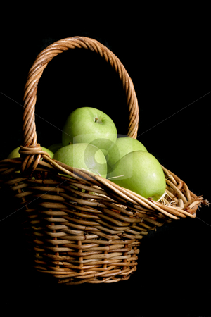 Green apple Basket stock photo, Fresh picked green apples in a wicker basket on a black background by Leah-Anne Thompson
