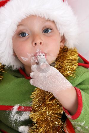 Baking Christmas Cookies stock photo, Toddler wearing a christmas hat, baking christmas cookies by Vanessa Van Rensburg