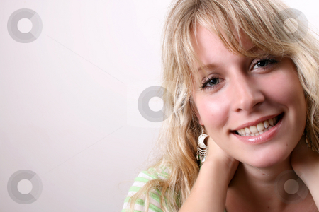 Blond Model stock photo, Blond Female model on a white background wearing a green top by Vanessa Van Rensburg