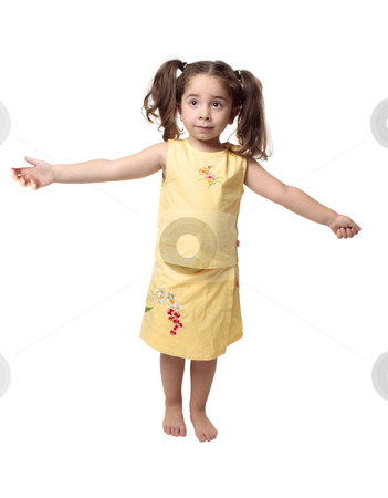 Little girl with arms outstretched stock photo, Small young girl standing with arms outstretched to the sides of her body. by Leah-Anne Thompson