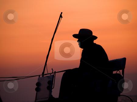 Cowboy stock photo, Cowboy in coachman by Portokalis