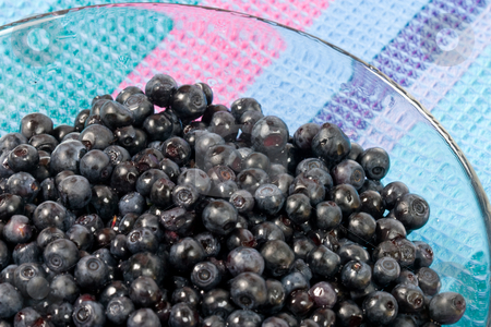 Bilberries stock photo, Food series: ripe bilberries in the glass bowl by Gennady Kravetsky