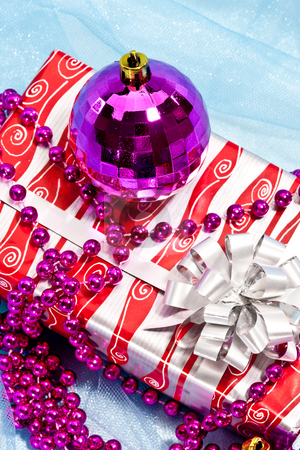 Christmas decoration stock photo, Holiday series: christmas gift with purple ball decoration and garland by Gennady Kravetsky