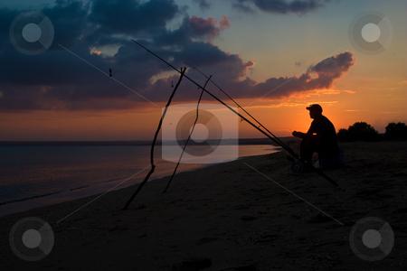 Fisherman stock photo, People series: fisherman sit on the beach of sea by Gennady Kravetsky