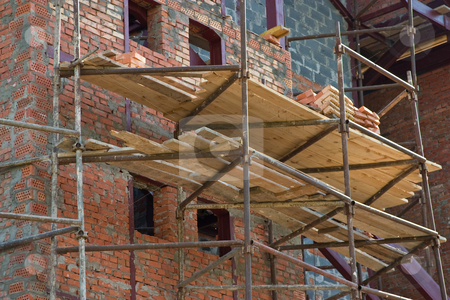 Under construstion stock photo, City series: building under construction with scaffolding by Gennady Kravetsky