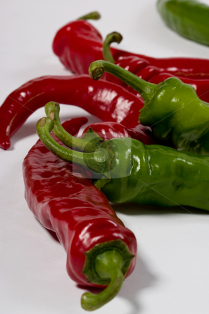 Pepper stock photo, Food series: bitter pepper red and green on the white by Gennady Kravetsky