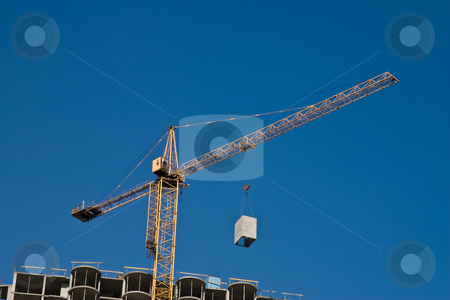 Construction site stock photo, City series: building under construction with crane by Gennady Kravetsky