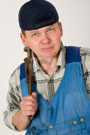Alligator wrench stock photo, Portrait of workman with alligator wrench by Gennady Kravetsky