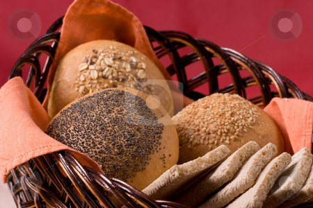 Buns stock photo, Some buns on the bread basket by Gennady Kravetsky