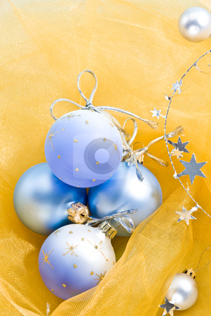 Christmas decoration stock photo, Holiday series: christmas blue ball  on yellow cloth by Gennady Kravetsky