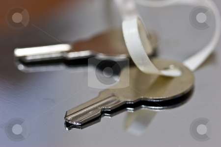 Key stock photo, Bunch of keys on the surface of mirror by Gennady Kravetsky