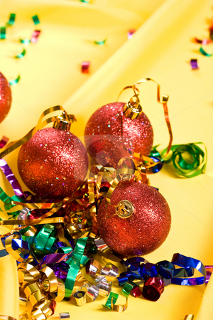 Celebration mood stock photo, Christmas series: red balls over yellow background by Gennady Kravetsky