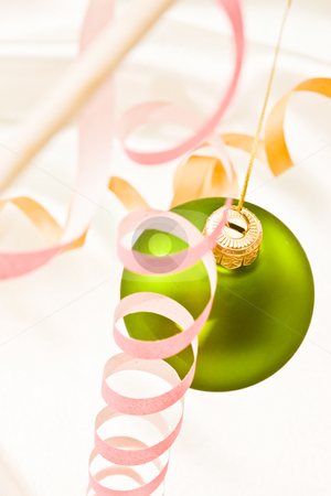 Christmas decoration stock photo, Holiday series: green Christmas ball and pink streamer by Gennady Kravetsky