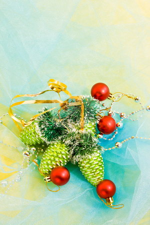 Christmas decoration stock photo, Holiday series: christmas red ball and green cone on blue cloth by Gennady Kravetsky