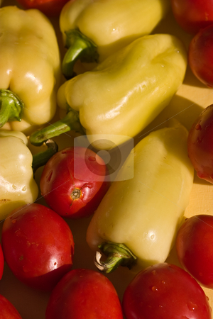Pepper and tomato stock photo, Food series: yellow pepper and red tomato by Gennady Kravetsky